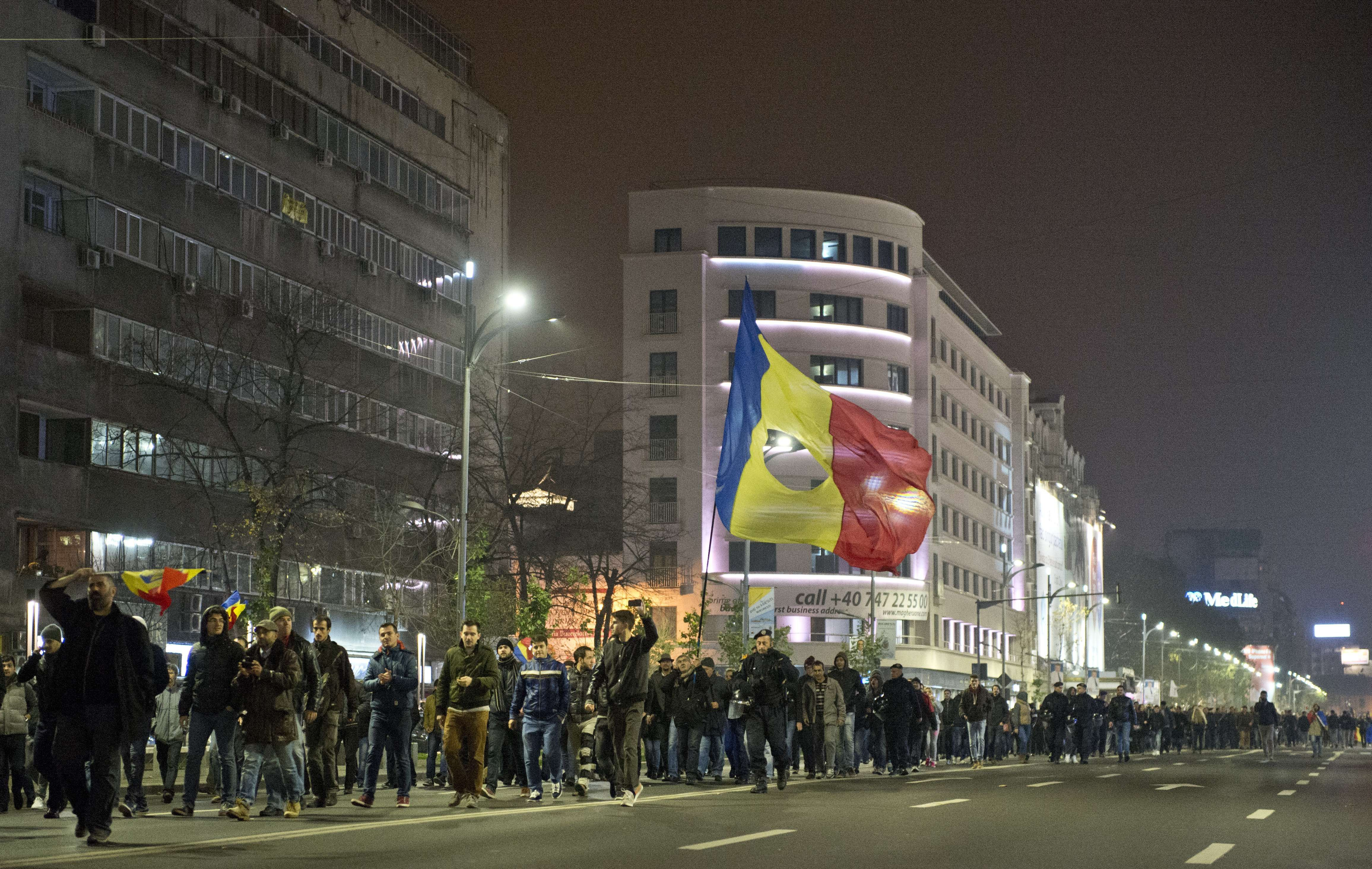 Romanian supporters of Conservative Klaus Iohannis march the streets