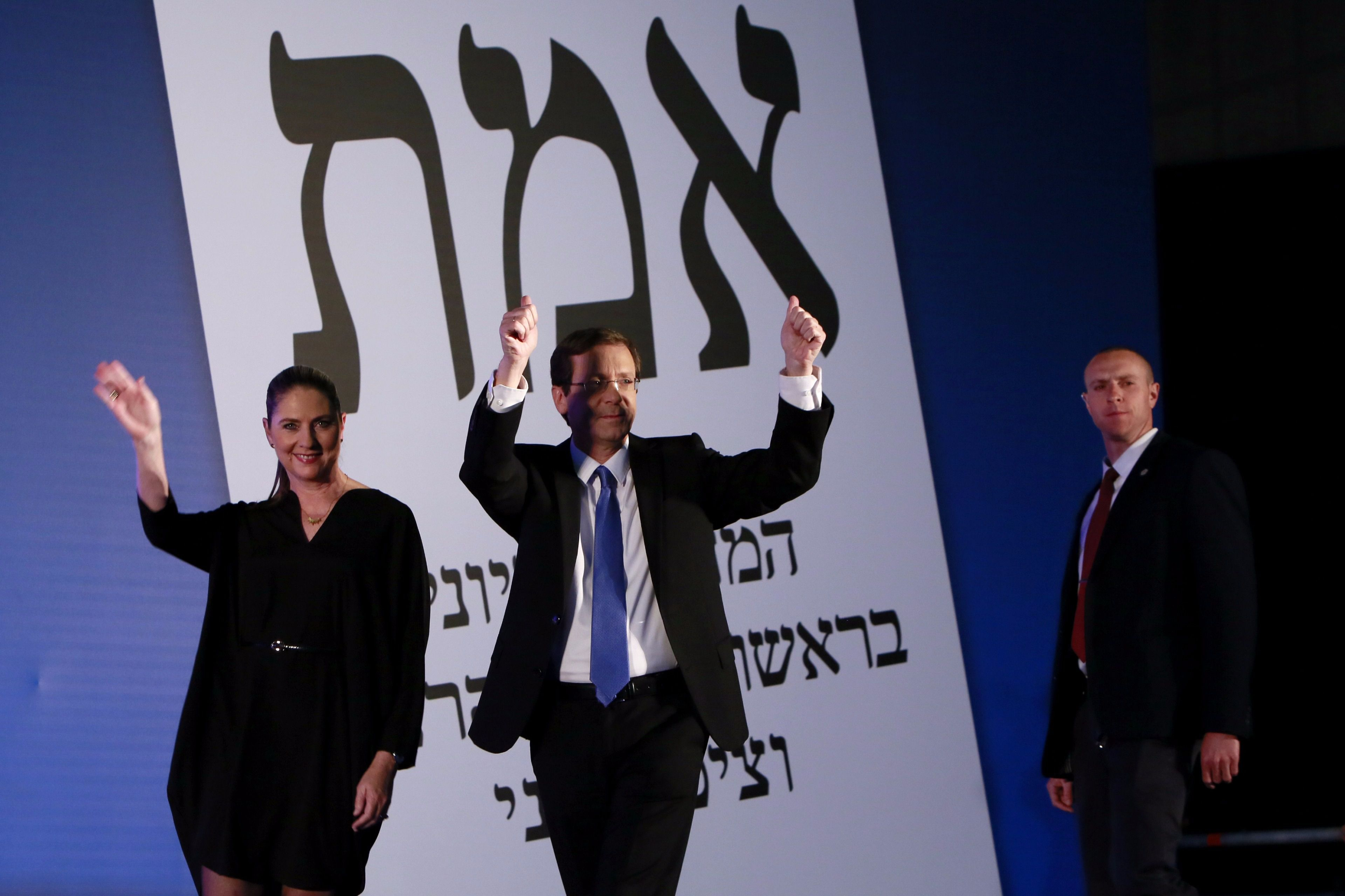 Israeli Labour Party leader Isaac Herzog arrives on stage with his wife Michal as he reacts to exit poll figures in Israel's parliamentary elections late on March 17, 2015 in the city of Tel Aviv.