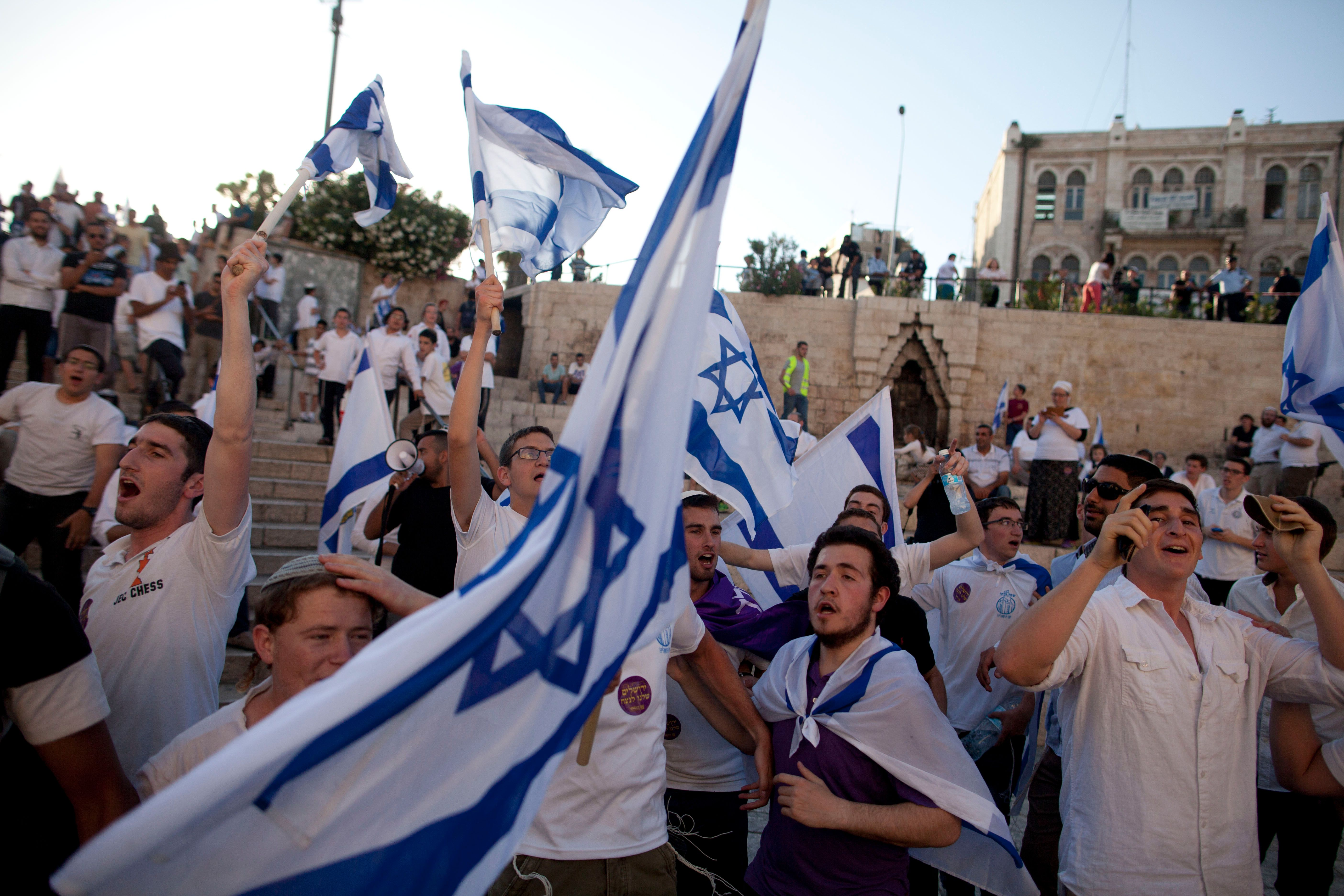 JERUSALEM, ISRAEL - MAY 17: Israelis dance with flags during a march marking Jerusalem Day on May 17, 2015 outside Jerusalem's old city, Israel. Israel is celebrating the anniversary of the 'unification' of Jerusalem, marking 48 years since it captured mainly Arab east Jerusalem during the 1967 Middle East war. (Photo by Lior Mizrahi/Getty Images)