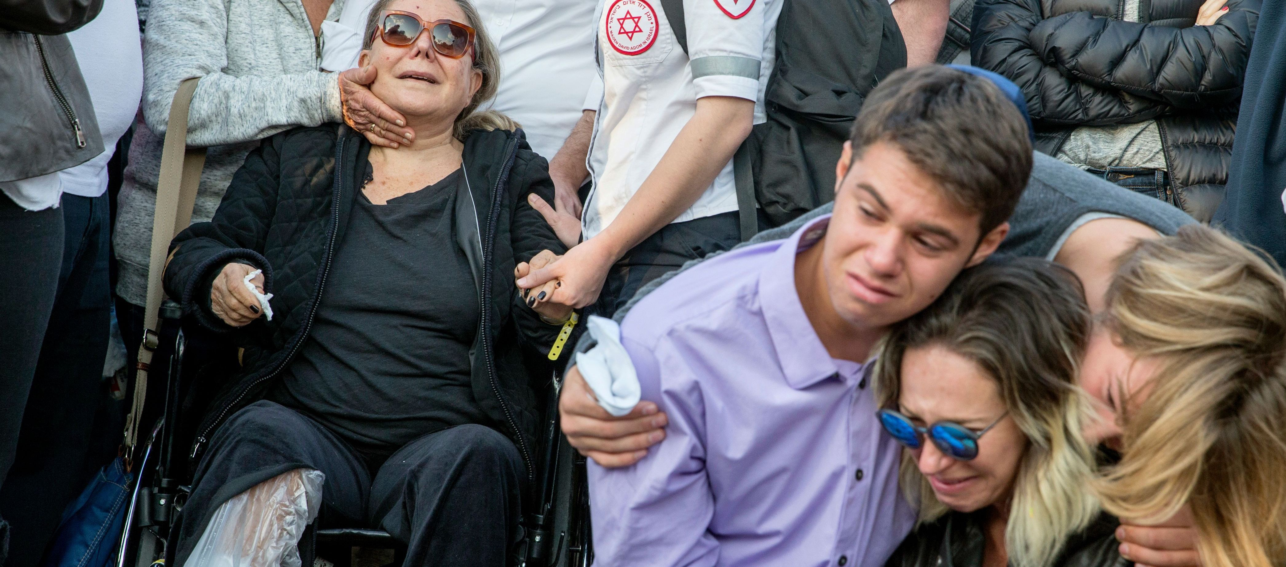Nitza (L) the wife of Avraham Goldman, 69, who was killed in a suicide bombing in Istanbul on March 19, 2016 mourns with their children at his funeral.