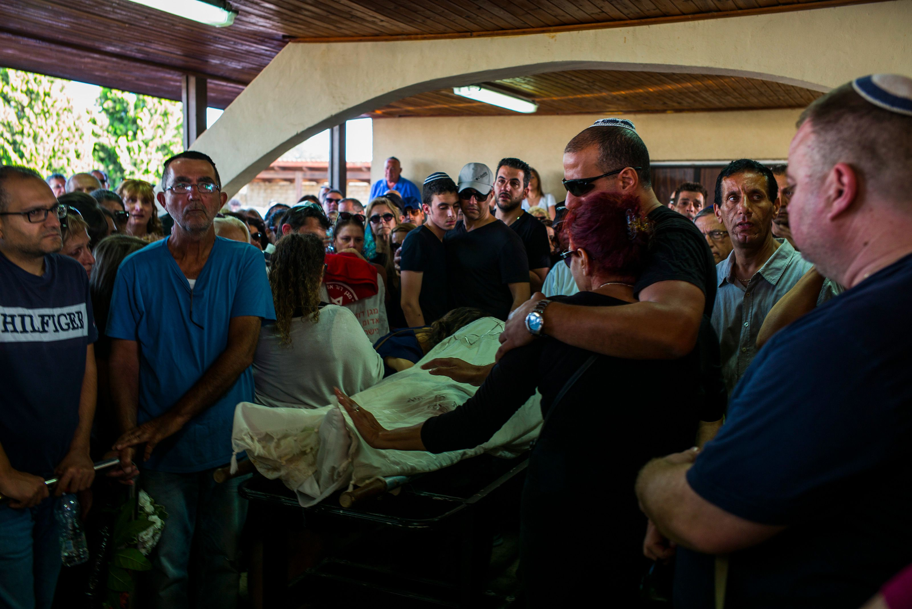 Family members of Ido Ben Ari mourning his death at his funeral on June 9, 2016 in Yavneh, Israel.