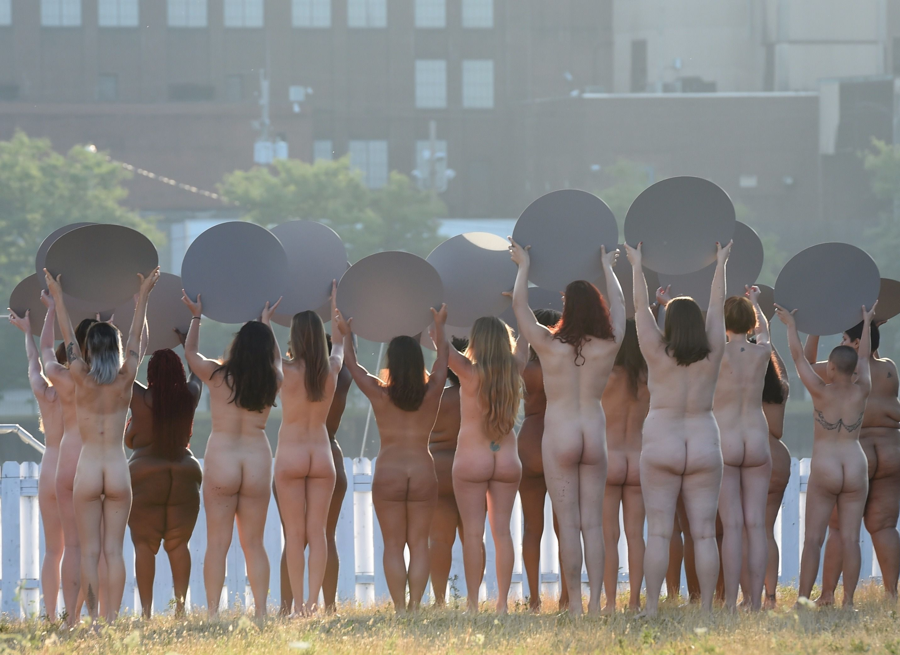 One hundred women posed nude in advance of the Republican National Convention on Sunday.