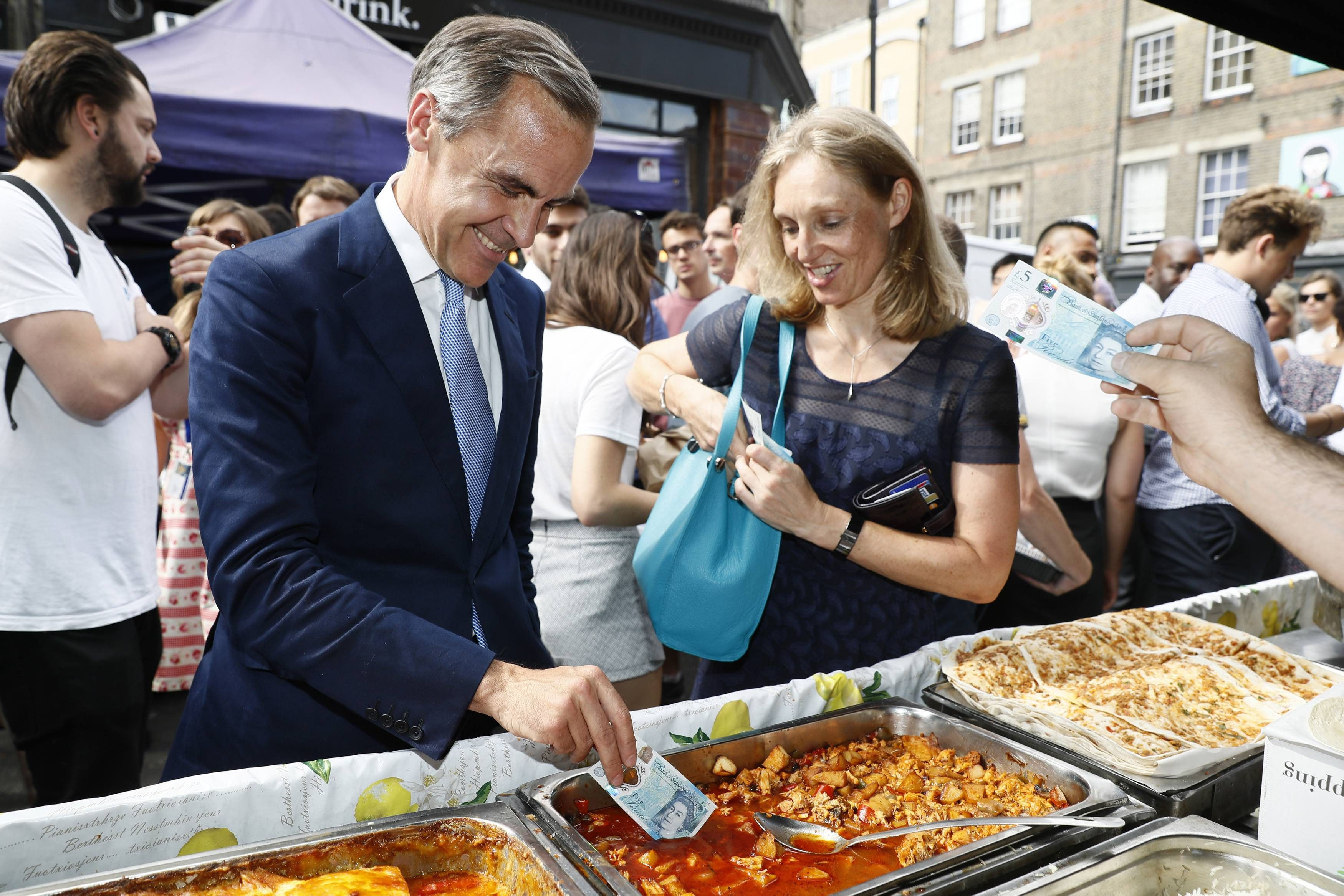 Mark Carney's Beef: Bank of England governor Mark Carney dips his new treyf 5-pound note into food.