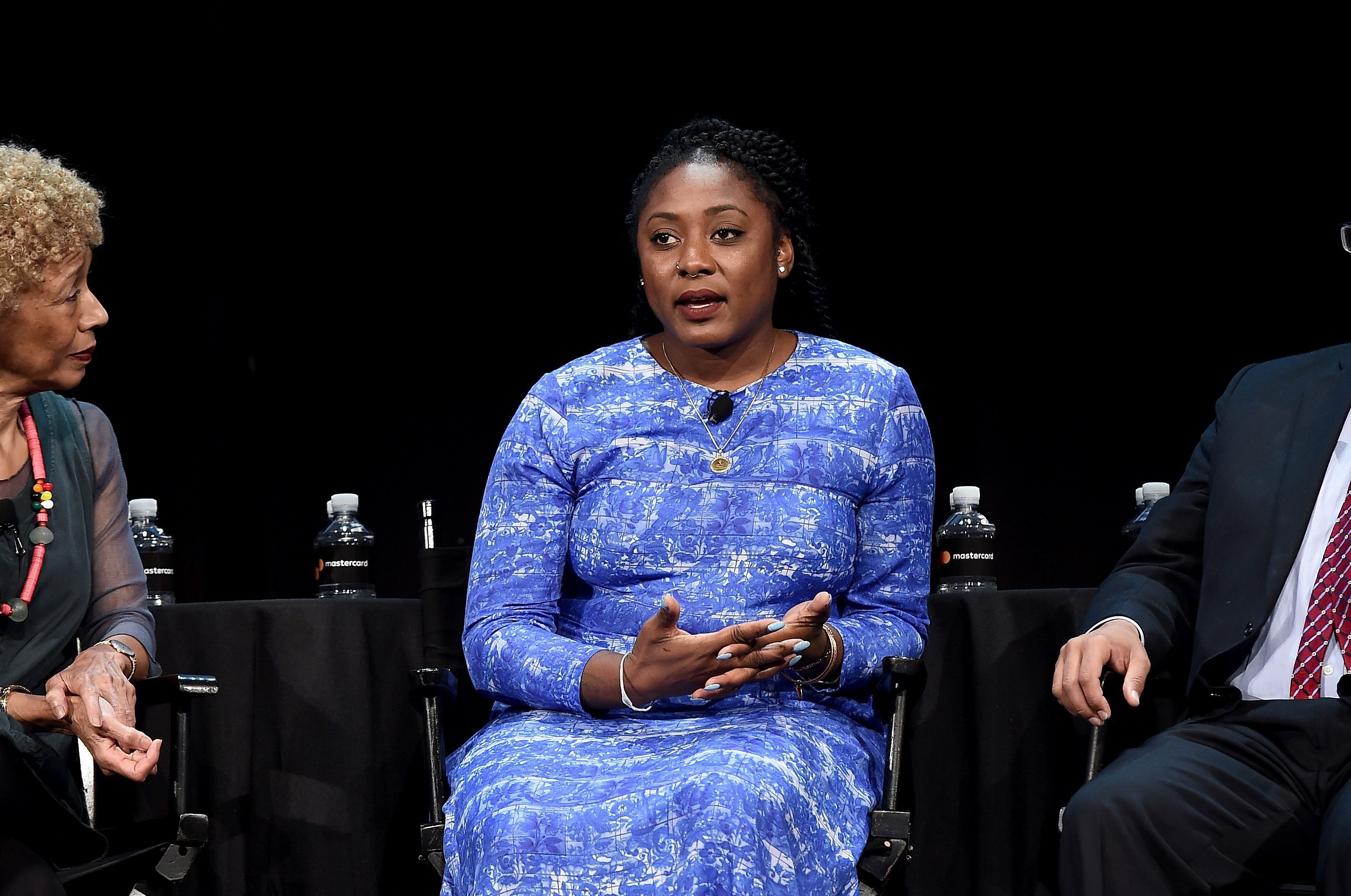 """Alicia Garza speaks during the panel discussion """"A More Perfect Union: Obama and The Racial Divide,"""" at the 2016 New Yorker Festival."""