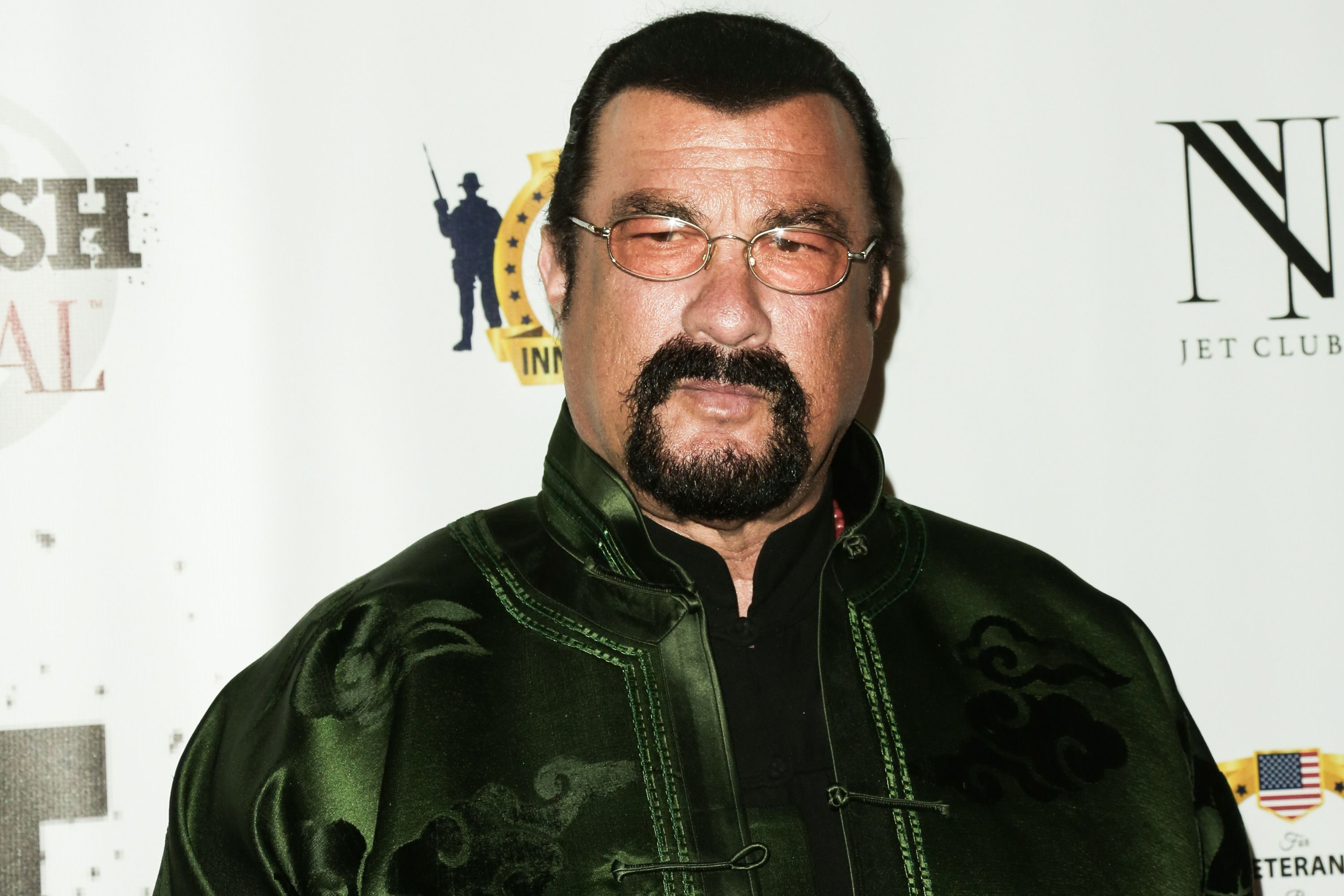George Foreman challenges Steven Seagal to fight