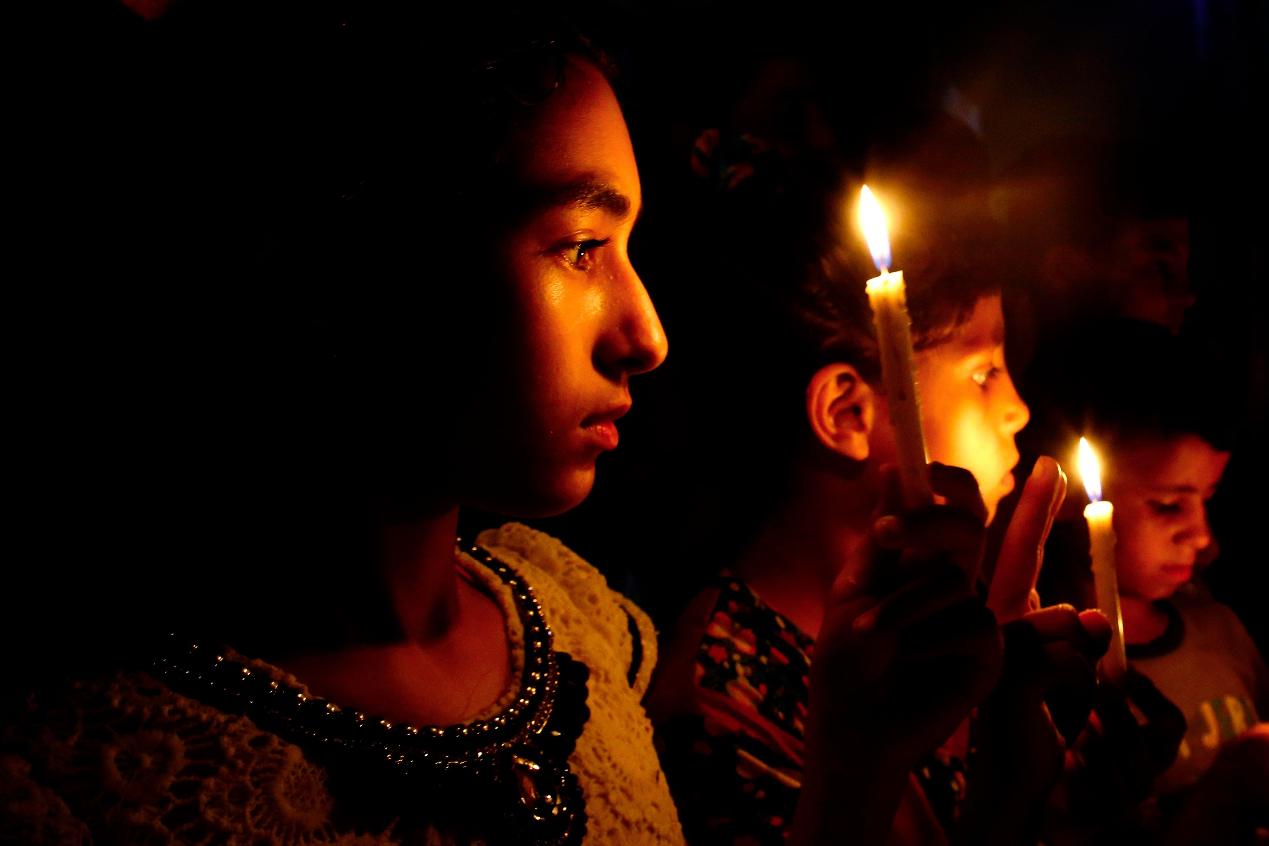 Palestinian children hold candles during a protest against the blockade on Gaza Strip in Gaza City on July 14, 2017. The United Nations warned earlier in the month that the Gaza Strip may already be 'unlivable', after a decade of Hamas rule and a crippling Israeli blockade.