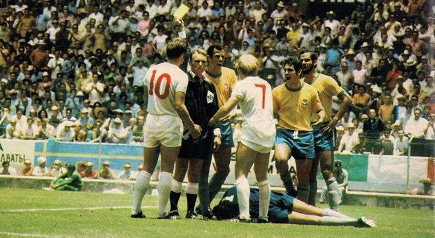 Booked!: Referee Klein calmly books Francis Lee (England No. 7) for a foul on the Brazilian goalkeeper Felix, as Geoff Hurst and Brazilians look on.