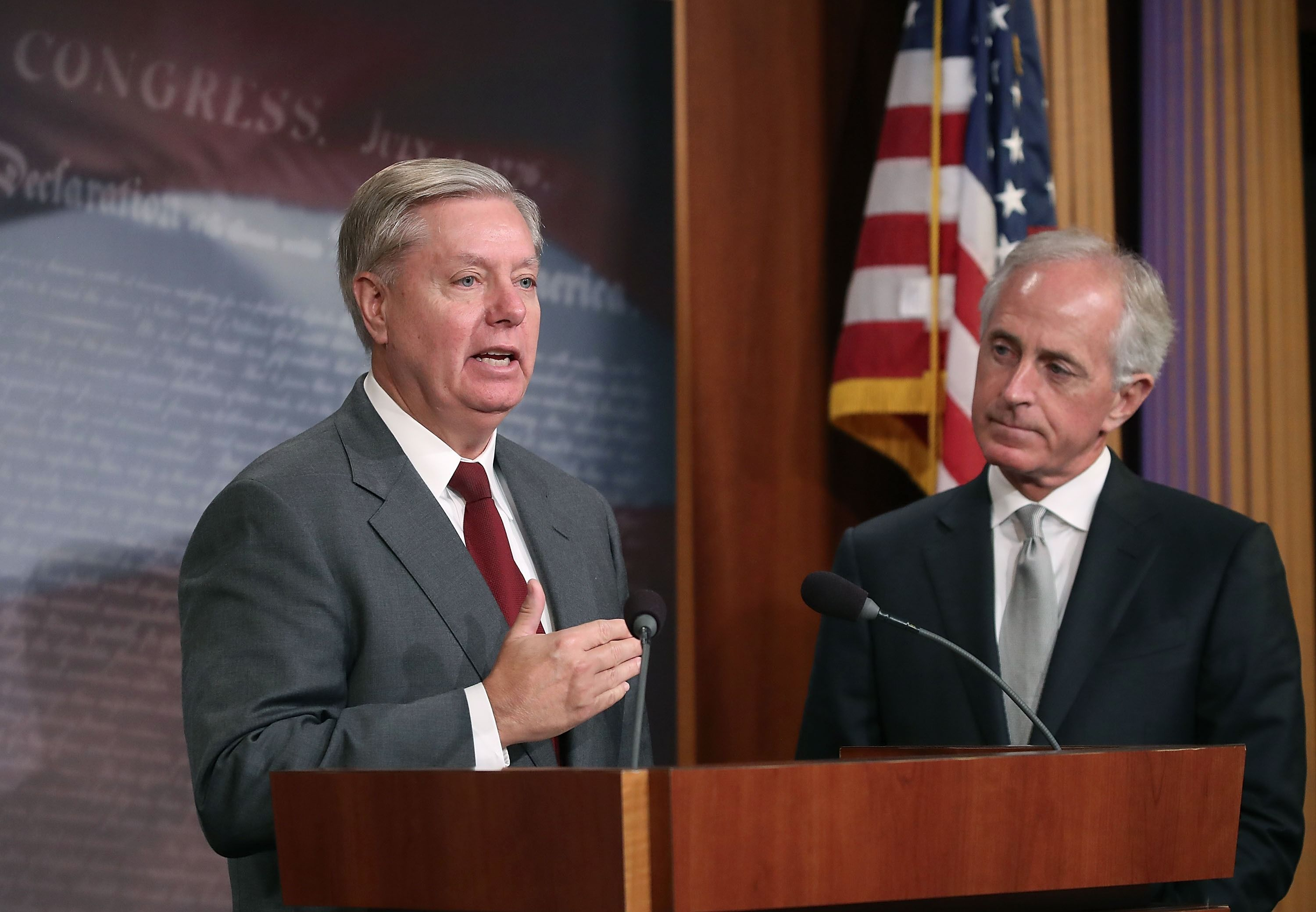 Senators Lindsey Graham (left) and Bob Corker discuss the Taylor Force Act, August 3, 2017