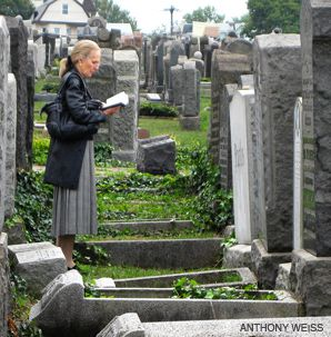 PRAYER FOR THE DEAD: Esther Friedman (above) journeyed to the city of her youth from Queens to pray at her grandfather?s grave on Newark, N.J.?s most recent annual safe day for Jewish mourners.