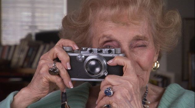 Still Watching: Ruth Gruber models the same Leica she had in Alaska.
