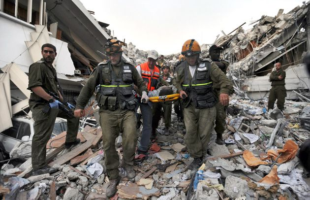 To the Rescue: Israeli relief workers carry an injured man rescued from a building collapse in Port- au-Prince, days after the earthquake left Haiti?s capital in ruins.