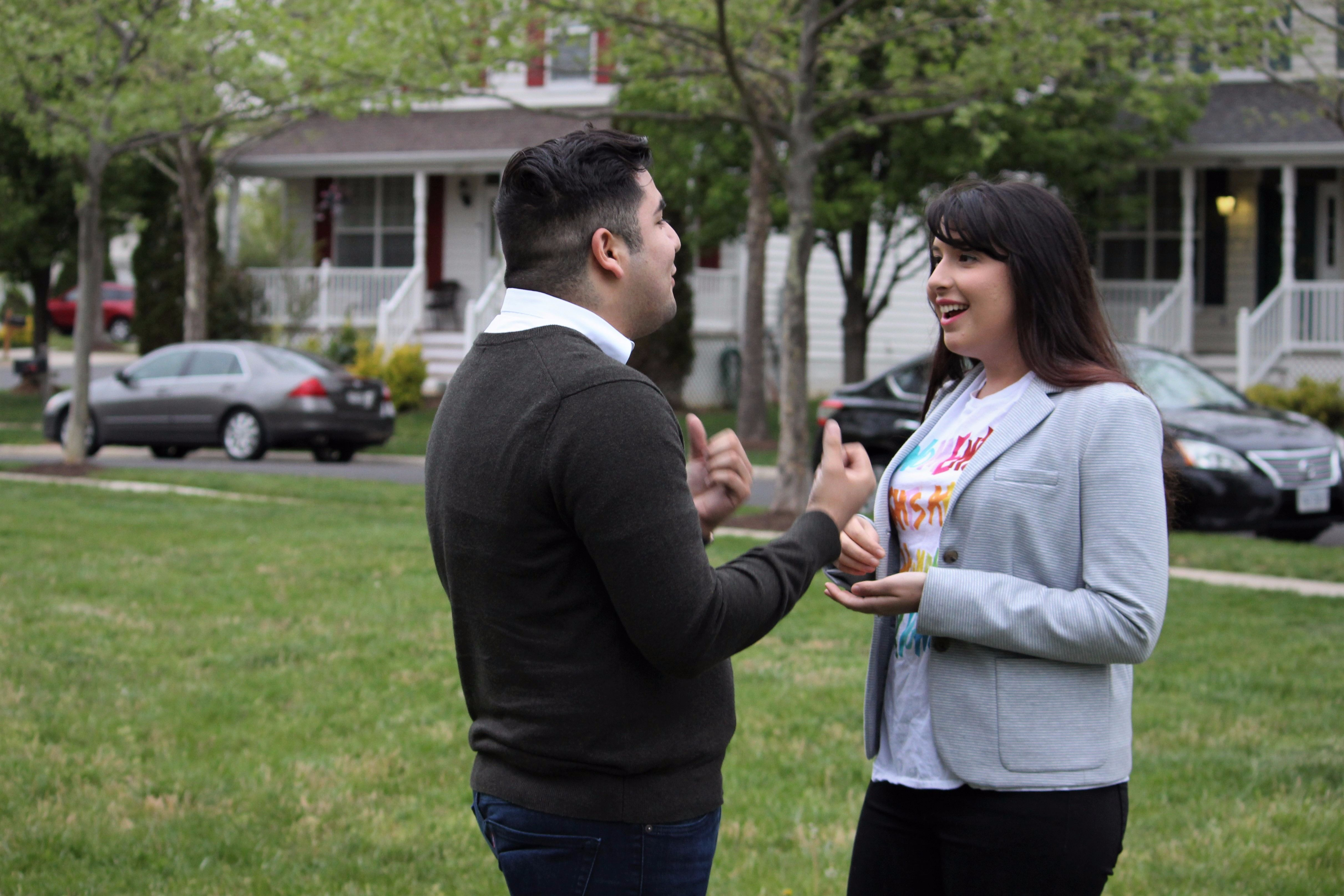 Hannah Risheq speaking to a voter in Virginia