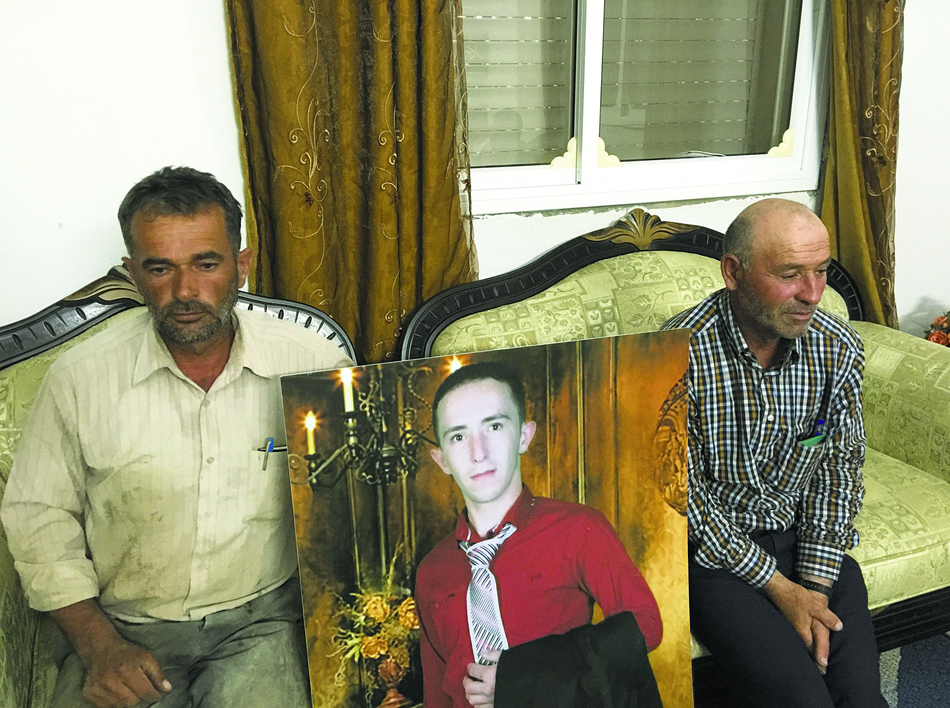 Family Mourns: Yusri Sharif (left), father of Abdul Fattah Sharif, and Fathi Sharif, the young man's uncle, attribute lone-wolf knife attacks by young Palestinians to the humiliation  of occupation.