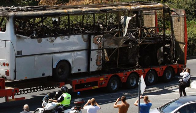 Damage: A truck carrying the bus that was damaged in a terrorist attack, outside Burgas Airport, Bulgaria