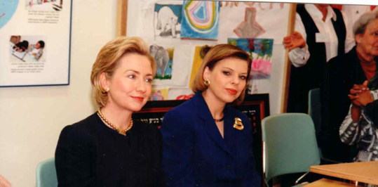 A young Hillary Clinton and Sara Netanyahu admire the HIPPY program Clinton imported to Arkansas from Israel.