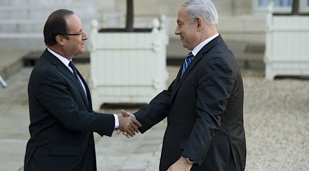 New Partnership: French president Francois Hollande and Benjamin Netanyahu stand together on continued economic sanctions of Iran.