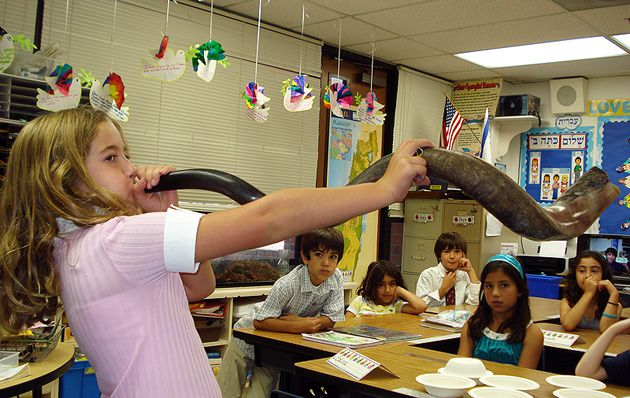 A New Year: A fourth-grade pupil at the Stephen S. Wise Temple Elementary School in Los Angeles learns how to blow the shofar, the traditional sound of the start of Rosh Hashanah.