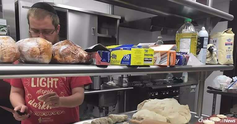 A volunteer prepares kosher food for people affected by the flooding at the Texas Medical Center in Houston.