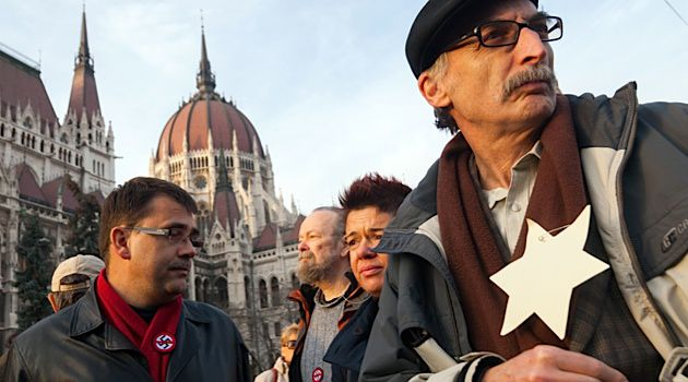 Protesters gather outside of the Hungarian Parliament to speak out against domestic anti-Semitism.