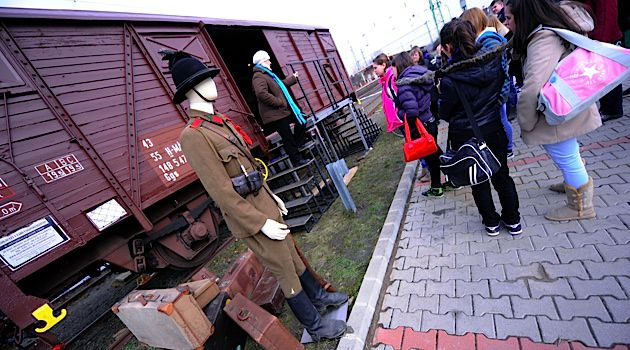 Students visit an outdoor exhibit on the Holocaust in Hungary.