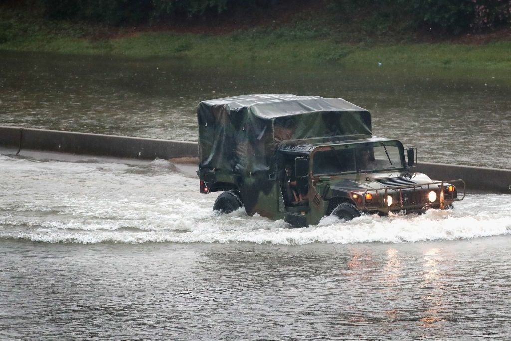 A military truck navigates through Houston, which has been inundated with flooding from Hurricane Harvey.