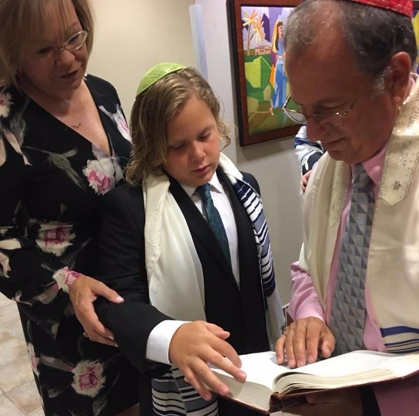 Adam Buchsbaum, flanked by his mother Laurie and Beth Yeshurun congregant Dr. Mark Gottesman, was able to have a Bar Mitzvah at a neighboring synagogue after his closed due to Hurricane Harvey.