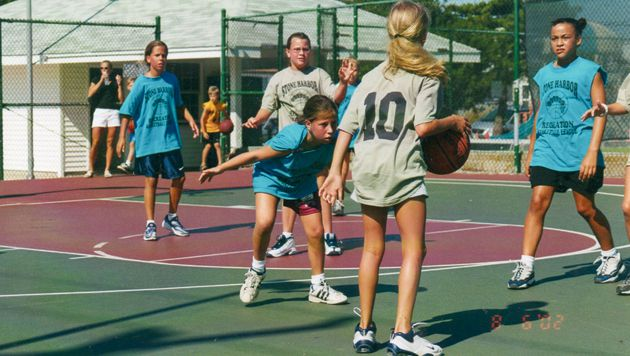 High Praise, Low Score: Strauss?s parenting method includes lauding his daughters even when they come in dead last or are the low scorers in sporting events. Above, Ella (center, blue shirt) guards a much taller competitor.