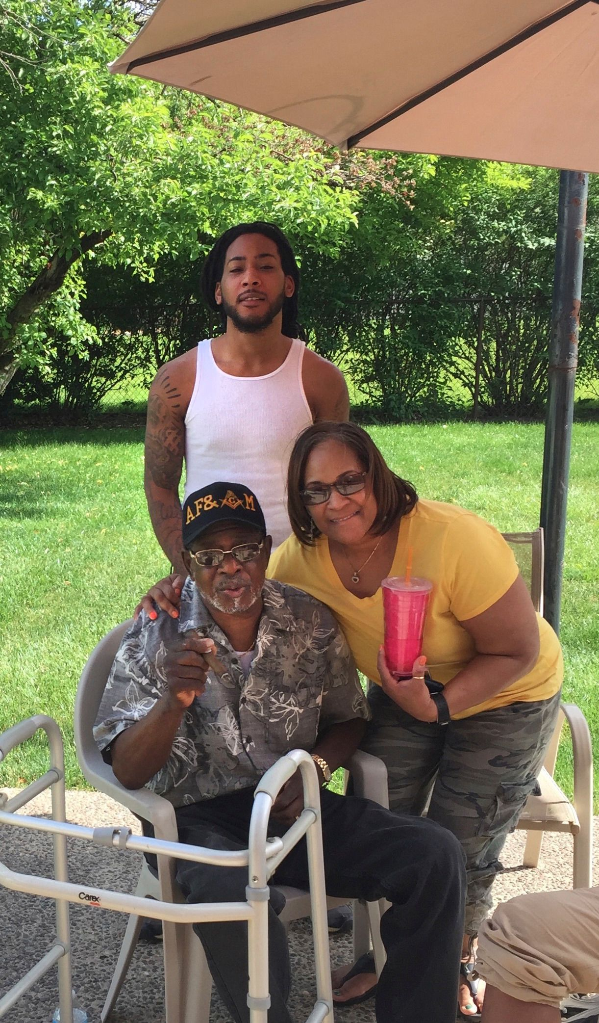 Tried and Tested: Angel Moses (right) with her father, George Moore, and son, Marcus.