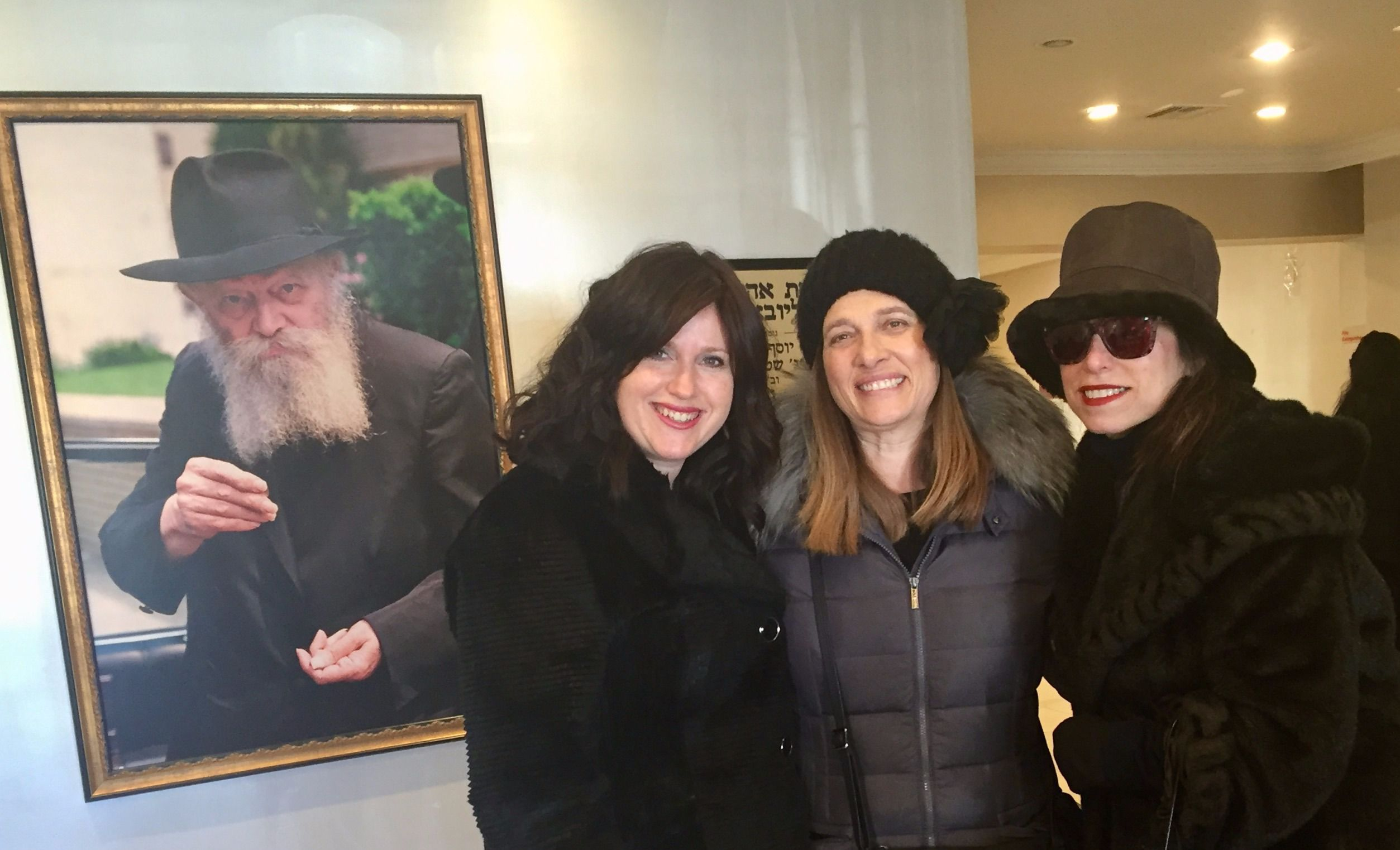 The author, rebbitzen Chanie Wolowik and Tammy Friedman at the Rebbe's grave.