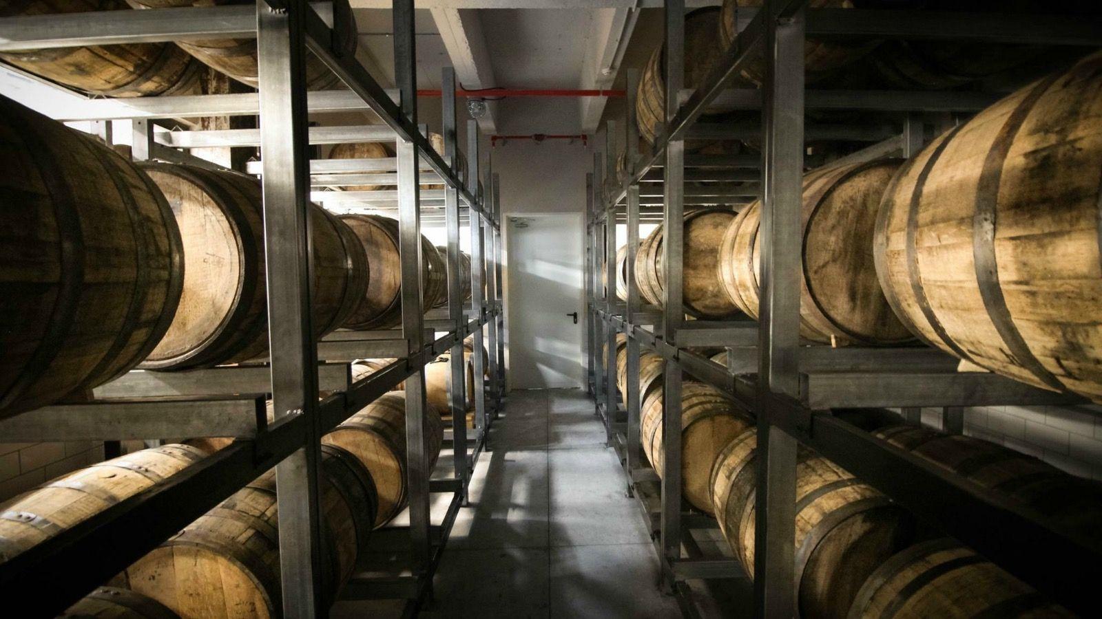 Dozens of barrels of Milk and Honey Whisky.