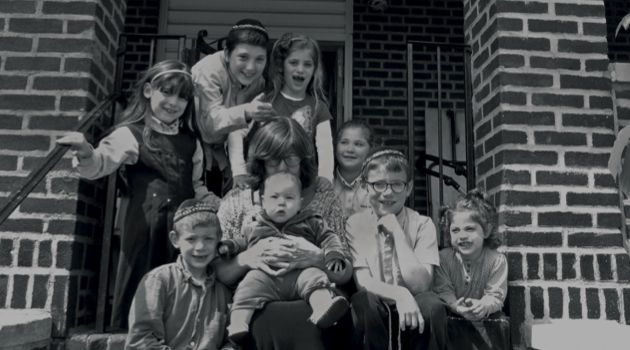 Her Own Brood: Rochel Vail poses with eight of her nine grandchildren on the porch of her Crown Heights, Brooklyn home.