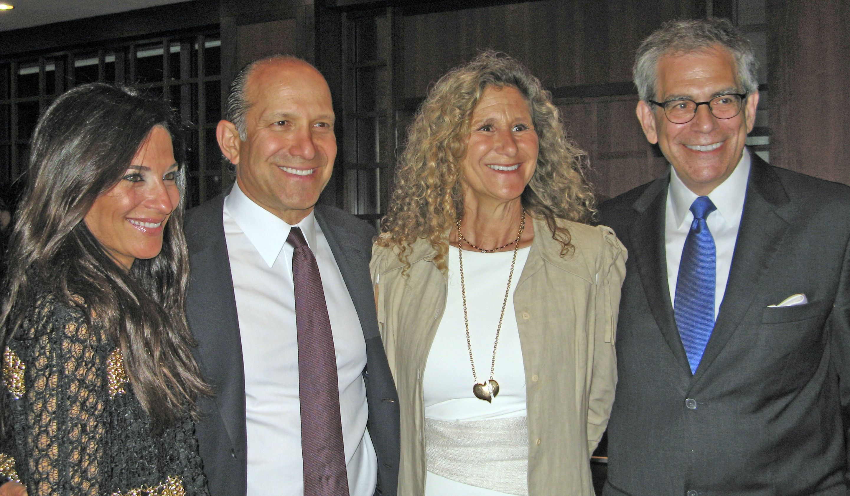 Allison and Howard Lutnick, Edie Lutnick and David Marwell