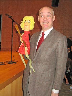 Shane Baker holds up a Mina Bern puppet.