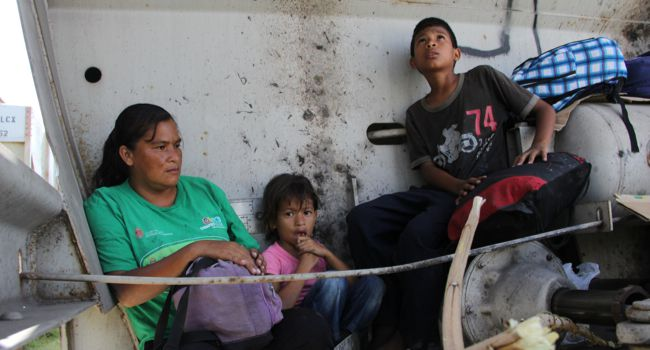 Limbo: A Central American immigrant and her children sit inside the so-called La Bestia (The Beast) cargo train, in an attempt to reach the Mexico-US border, in Arriaga, Chiapas state, Mexico.