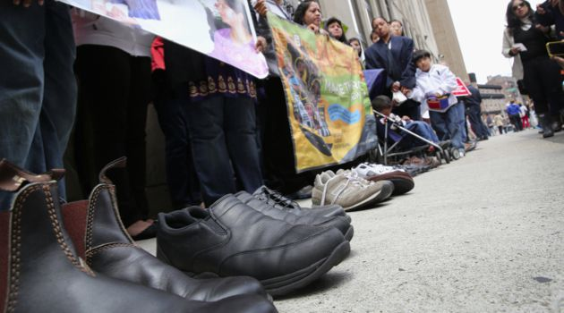 Gone: Shoes symbolizing deported fathers are displayed during a demonstration, organized by the New York Immigration Coalition, outside a detention facility run by Immigration and Customs Enforcement on June 14.