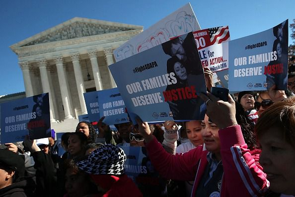 Protesters rally in front of the Supreme Court in support of President Barack Obama's immigration policies.
