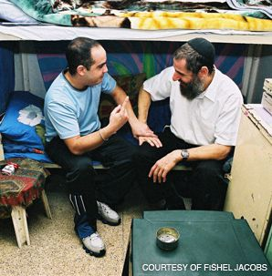 REPENTANCE: Rabbi Fishel Jacobs, right, has served as a chaplain in Israel?s prisons. He says prisoners often come to religion and by doing so benefit in sentencing hearings.