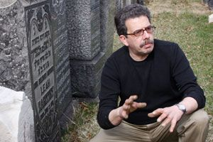 Grave Keeper: HBO researcher, Michael Hirsch, spruces up the graves of Christian and Jewish victims of the Triangle fire.