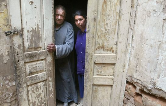 No Place Like Home: Iraqi Jews Jakob Yusef, 70, and niece Khalda Salih, 38, stand in their home in the tiny remaining Jewish community in Baghdad, Iraq.