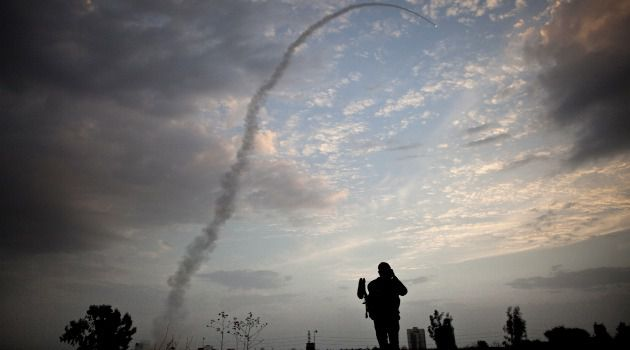 In Iron Dome We Trust: An Israeli observes the anti-missile defense system in action.