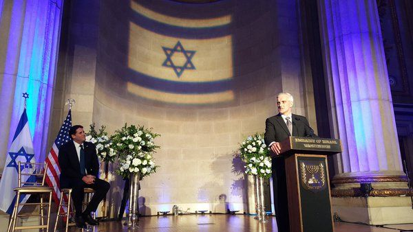 White House Chief of Staff Denis McDonough speaks, as Israeli ambassador to Washington Ron Dermer looks on at the Israeli embassy's Independence Day reception in Washington, D.C., on May 12 2016.