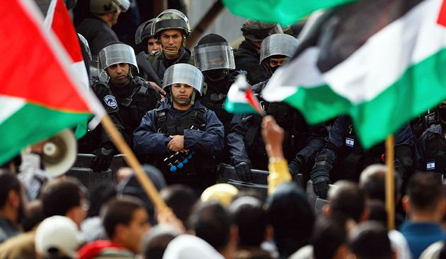 House Divided: Israeli Arabs faced off against police in Umm al-Fahm in March during a march by right-wing Jews through the Muslim town.