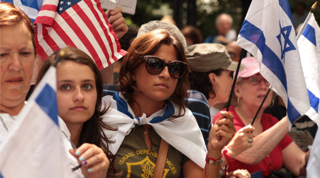 Standing for Israel: Demonstrators wave Israeli flags in support during rally outside United Nations in New York.