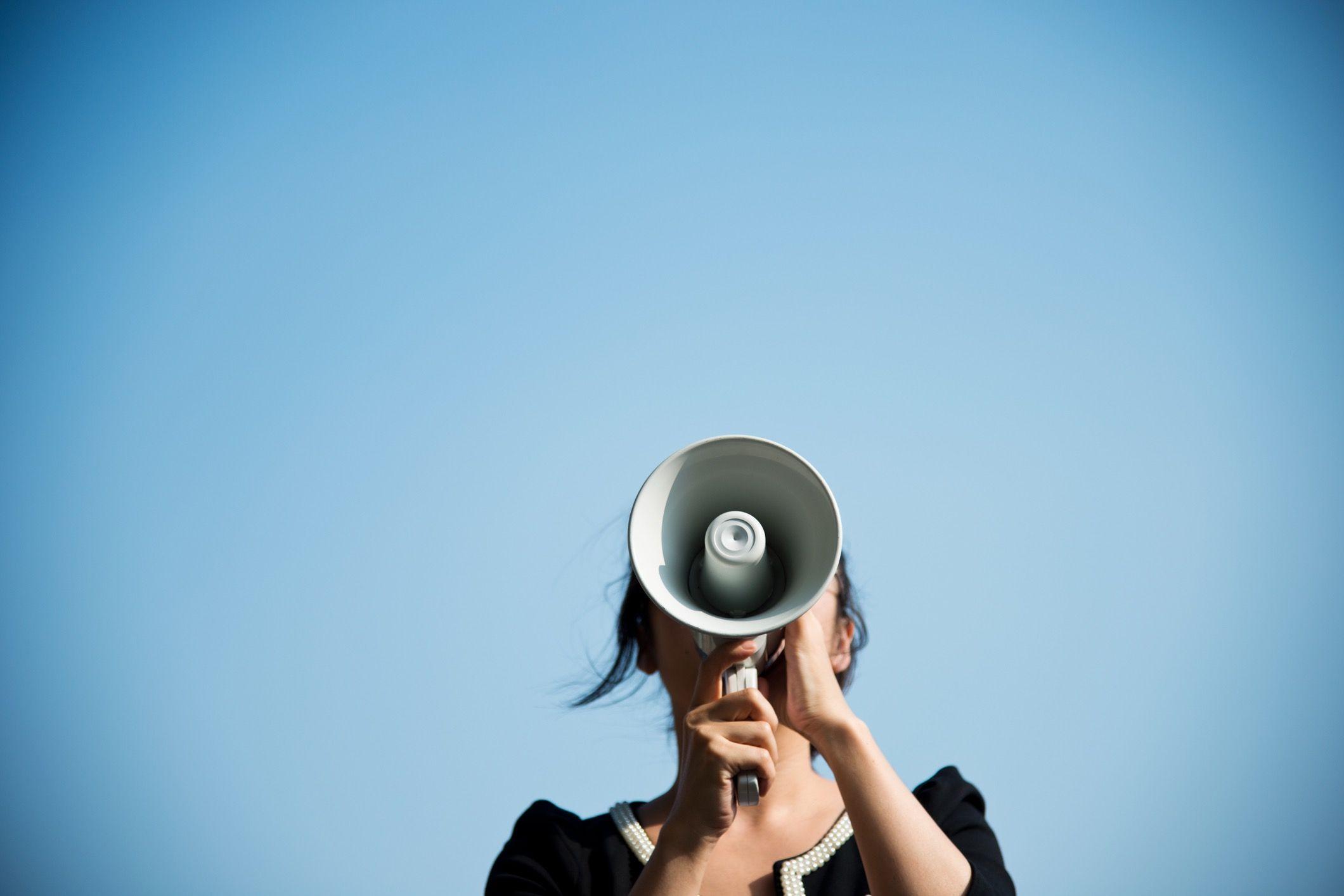 Woman speaking through megaphone