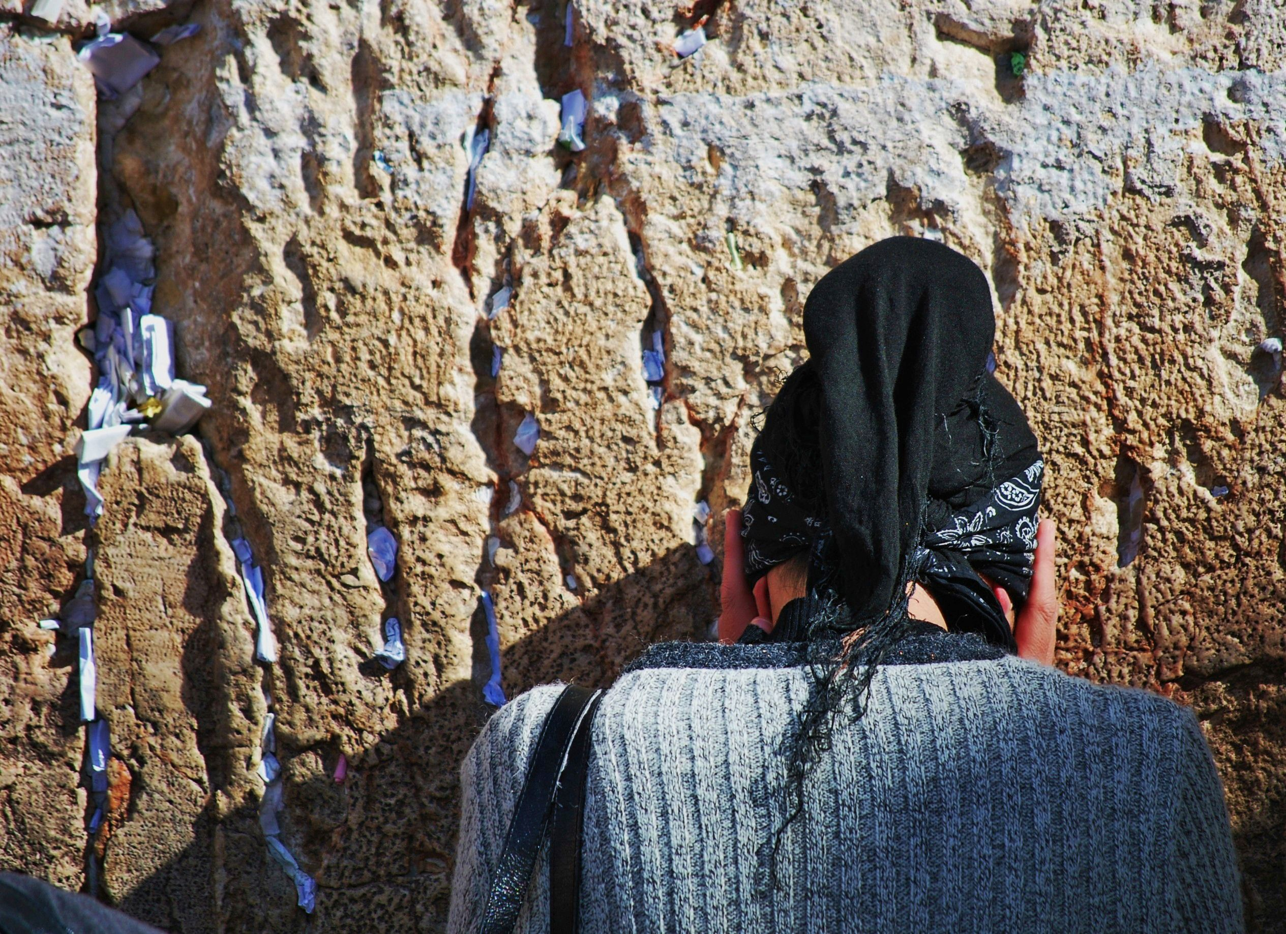 Jewish woman prays at the Western Wall.