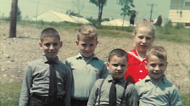 As Children: Jackie Jacobs (back row, middle) poses with his sister Ethel and brother Gerald (front row, right) and with two cousins in ties.