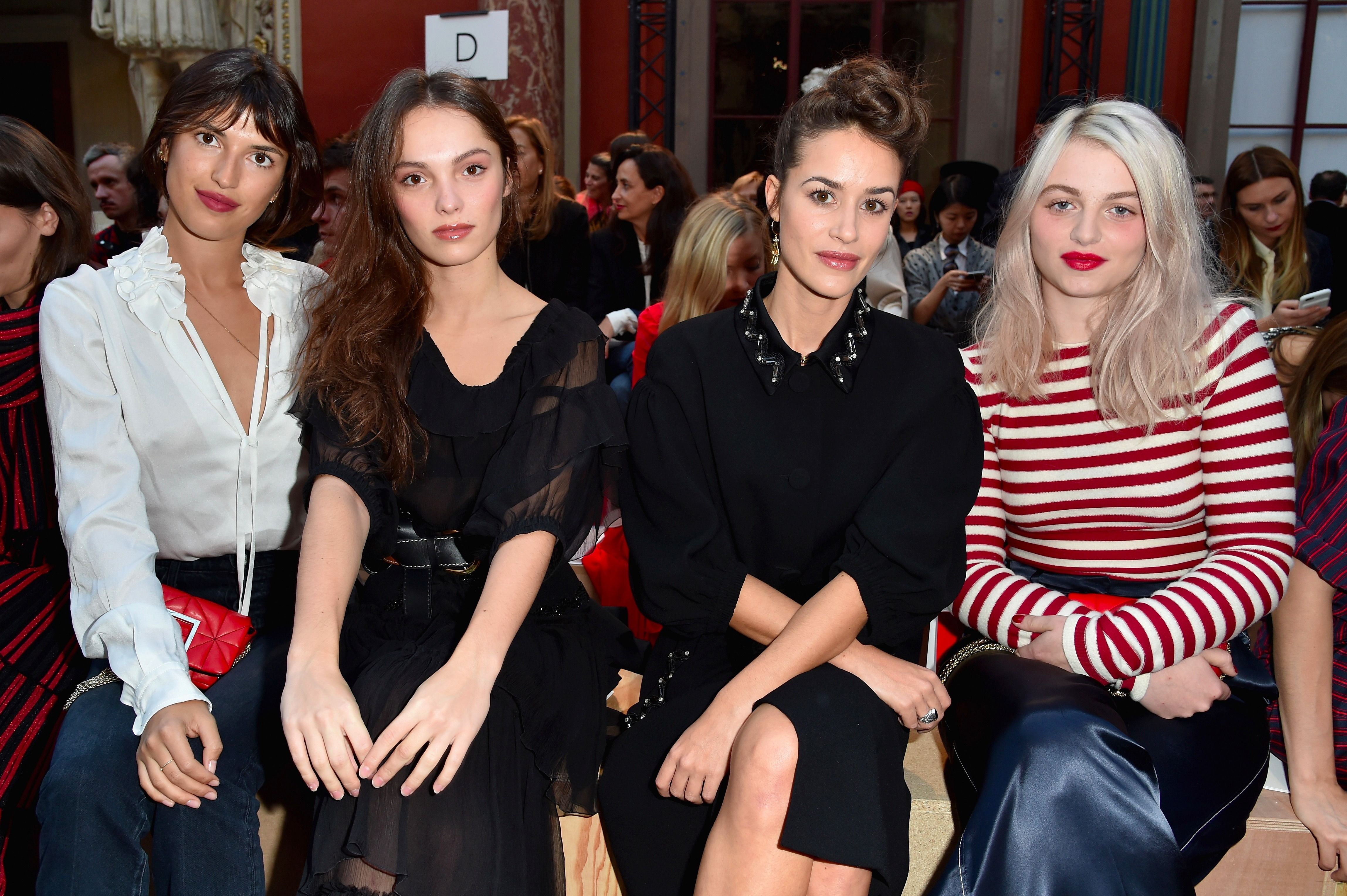 Jeanne Damas, left, in a front-row seat at Paris Fashion Week.