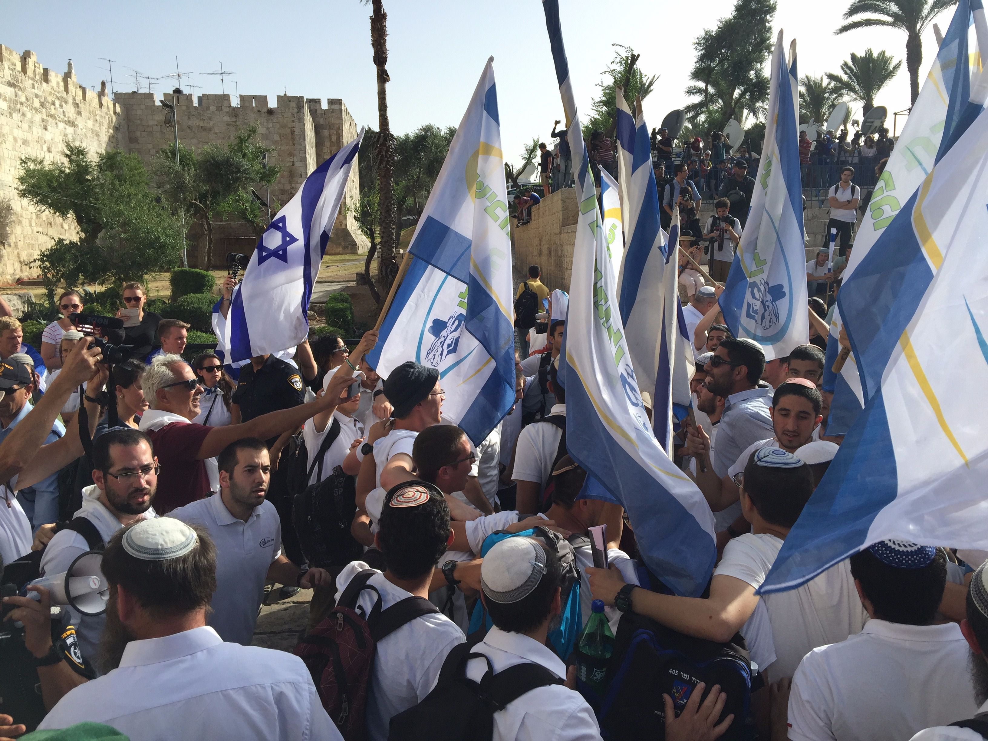 Orthodox teens get set to march with flags through Jerusalem's Old City, including its Arab quarters, on Jerusalem Day, Sunday.