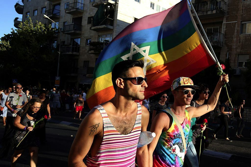 Israelis carry a gay pride rainbow flag with the Star of David during the annual Jerusalem Gay Pride Parade on July 21, 2016.