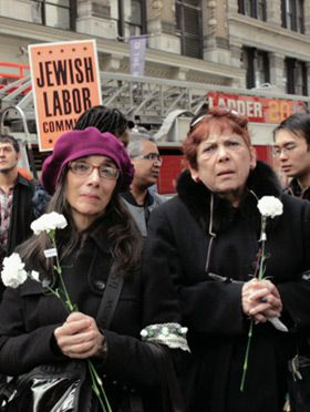 Remembering the Fire: Attendees clutch white flowers at the March 27 commemoration of the Triangle Shirtwaist Factory fire. The annual ceremony is sponsored by Unite Here, a descendant of the large, predominately Jewish unions representing garment workers.